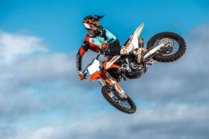 Tail whip on a KTM bike